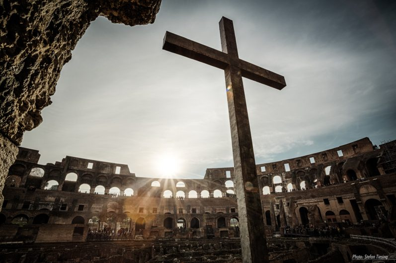 Christian takeover of an roman icon (Cross inside Colosseum Amphitheatre, Rome)