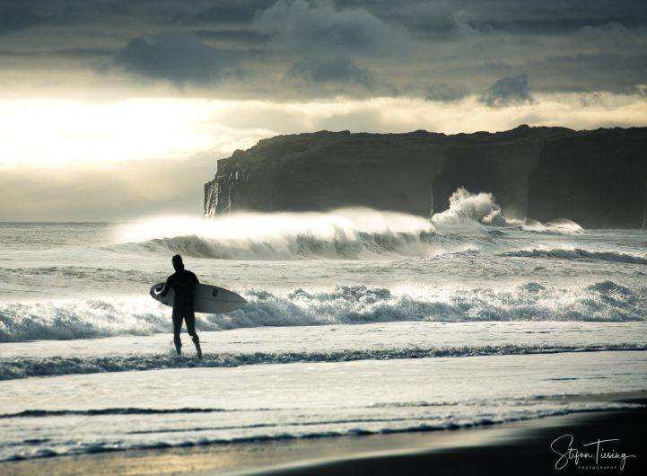 Surfing at Mana Bay